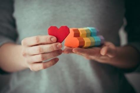 pride-network-rainbow-hearts-in-hand-shutterstock_244347013-500w